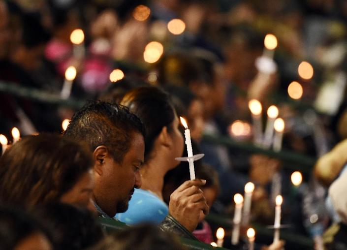 People attend a candlelight vigil at the San Manuel Stadium in San Bernardino, California, on December 3, 2015 for victims of the mass shooting in San Bernardino which left 14 dead (AFP Photo/Robyn Beck)