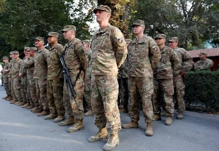 U.S. soldiers take part in a memorial ceremony to commemorate the 16th anniversary of the 9/11 attacks, in Kabul