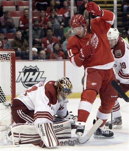 Detroit Red Wings right wing Daniel Cleary (11) screens Phoenix Coyotes goalie Mike Smith (41), who stops a shot in the first period of an NHL hockey game in Detroit, Thursday, Jan. 12, 2012. (AP Photo/Paul Sancya)