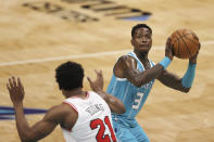 Charlotte Hornets guard Terry Rozier (3) shoots as Chicago Bulls forward Thaddeus Young (21) defends during the first half of an NBA basketball game in Charlotte, N.C., Thursday, May 6, 2021. (AP Photo/Nell Redmond)