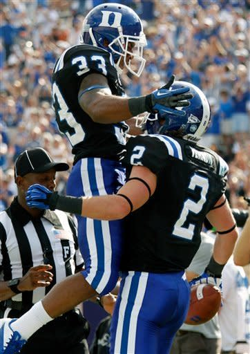 Duke wide receiver Conner Vernon (2) gets congratulated by teammate Desmond Scott (33) after he scored a touchdown during the first quarter of an ACC college football game against of Virginia in Durham N.C., on Saturday, Oct. 6, 2012. (AP Photo/The News & Observer, Chris Seward)