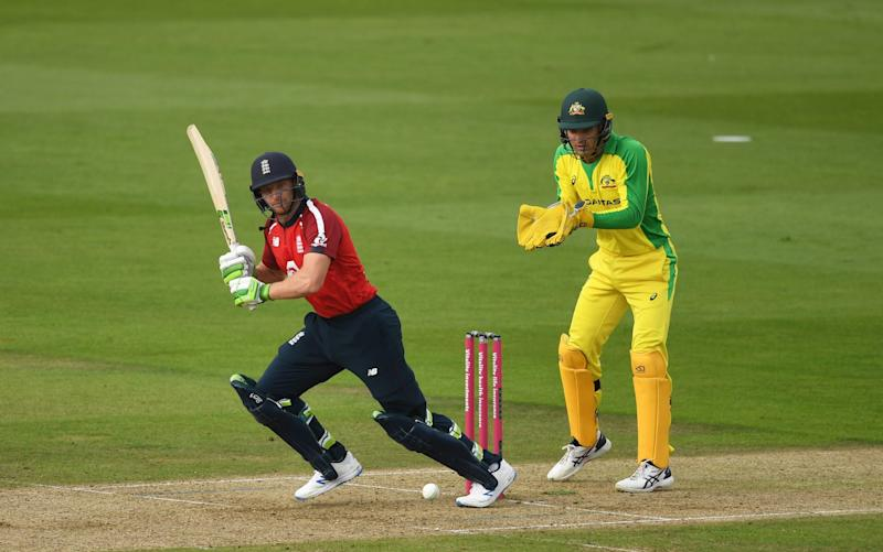 Jos Buttler of England(L) plays a shot as Alex Carey of Australia(R) looks on during the 2nd Vitality International Twenty20 match between England and Australia at The Ageas Bowl on September 06, 2020 in Southampton, England. - GETTY IMAGES
