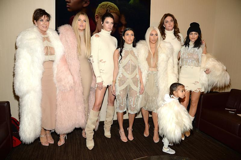 Caitlyn with the Kardashians backstage at Kanye West's Life Of Pablo album launch in 2016 (Photo: Kevin Mazur via Getty Images)