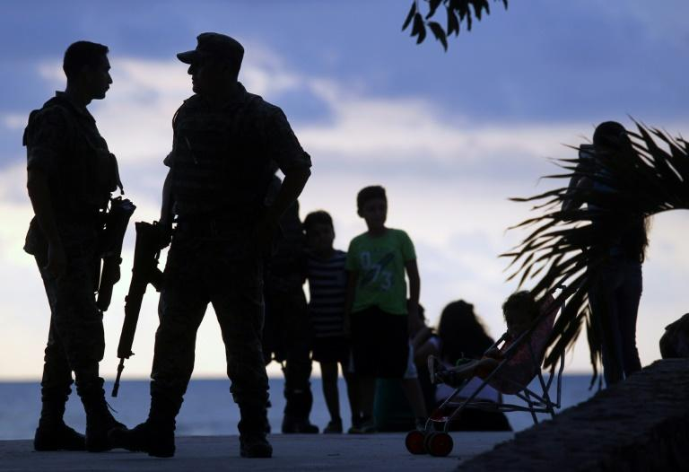 Mexican soldiers patrol the dock in Puerto Vallarta, in Mexico's Jalisco State, ahead of a summit of the Pacific Alliance