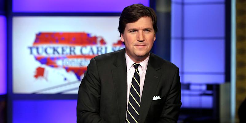 "FILE - In this March 2, 2017 file photo, Tucker Carlson, host of ""Tucker Carlson Tonight,"" poses for photos in a Fox News Channel studio, in New York. Carlson, who on Monday's show addressed the story of his former top writer, Blake Neff, who resigned after CNN found he had written a series of controversial tweets under a pseudonym, has left for vacation. It fits a pattern at Fox, whose personalities tend to go away to cool off when the heat is on. Carlson's vacation is the sixth example in a little more than three years. A Fox representative confirmed Carlson's vacation was planned before the Neff story broke. (AP Photo/Richard Drew, File)"