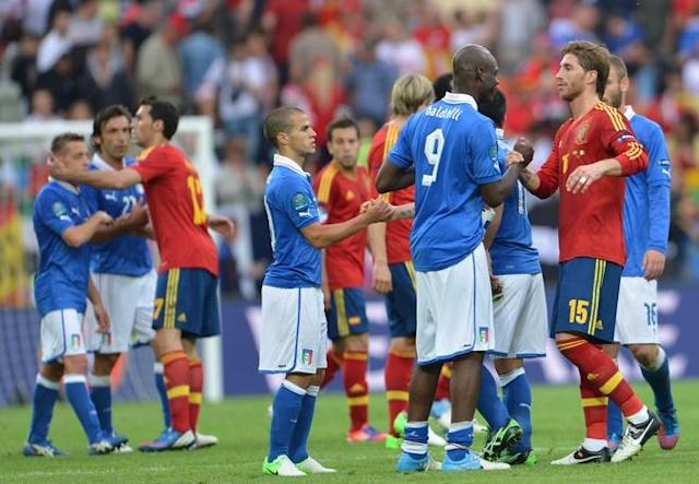 Italian forward Mario Balotelli (2ndL) reacts with Spanish defender Sergio Ramos the Euro 2012 championships football match Spain vs Italy on June 10, 2012 at the Gdansk Arena. The game ended in a draw 1-1. AFPPHOTO/ GIUSEPPE CACACEGIUSEPPE CACACE/AFP/GettyImages