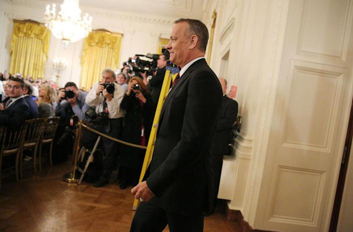 <p>Actor Tom Hanks walks to his seat before a ceremony awarding the Presidential Medal of Freedom to various recipients in the East Room of the White House in Washington, U.S., Nov. 22, 2016. (Carlos Barria/Reuters) </p>