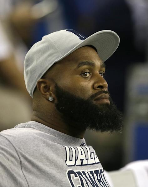 Dallas Cowboys' Anthony Spencer (93) watches from the sideline during an NFL football game against the New York Giants, Sunday, Sept. 8, 2013, in Arlington, Texas. (AP Photo/Tony Gutierrez)