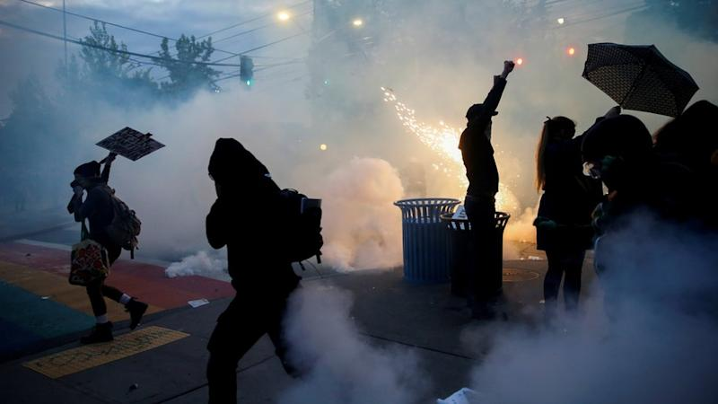 Police deploy tear gas and flashbang grenades against protesters