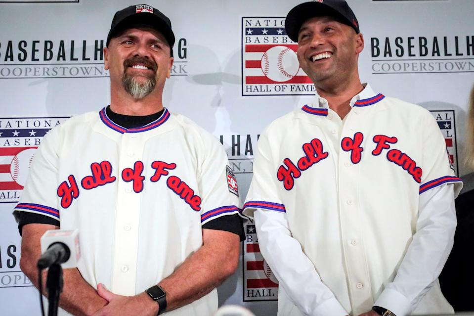 Derek Jeter, right, and Larry Walker pose after receiving their Baseball Hall of Fame jersey in 2020.