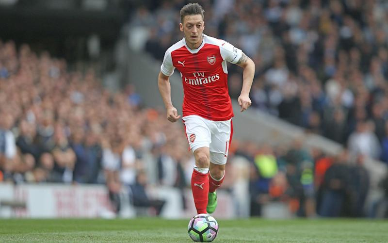 Mesut Ozil received plenty of criticism for his performance in Arsenal's 2-0 defeat at Spurs - Rex Features