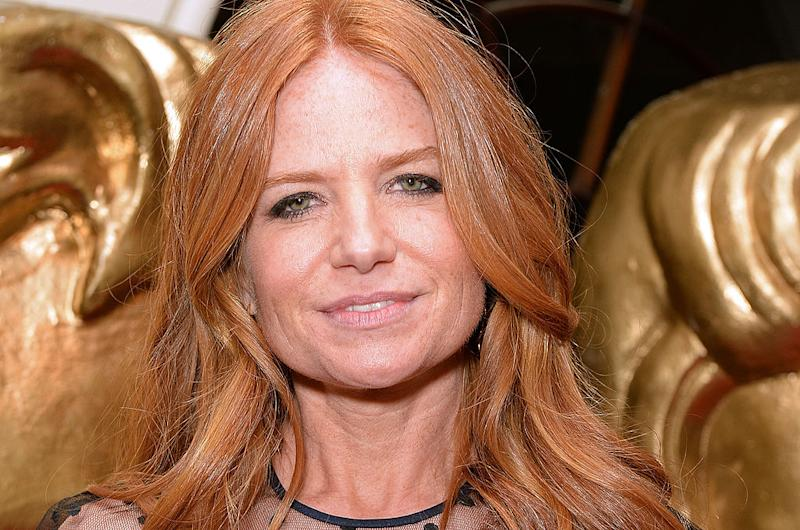 Patsy Palmer has revealed her red locks are turning grey and she's totally loving it, pictured here in 2014. (Getty Images)