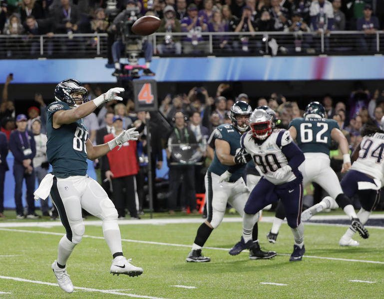 """FILE - In this Feb. 4, 2018, file photo, Philadelphia Eagles' Trey Burton, left, throws a touchdown pass to Nick Foles during the first half of the NFL Super Bowl 52 football game against the New England Patriots, in Minneapolis. The """"Philly Special"""" _ on a fourth down late in the first half of Super Bowl 52 will be remembered as one of the gutsiest calls in sports history. (AP Photo/Mark Humphrey, File)"""