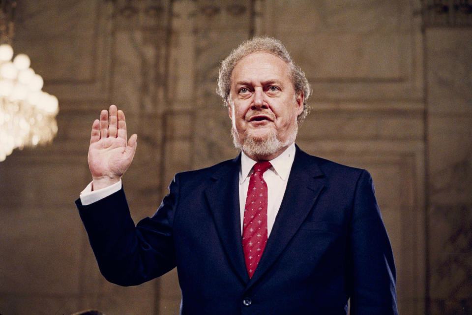 Judge Robert Bork, nominated by President Reagan to be an associate justice of the Supreme Court, is sworn before the Senate Judiciary Committee on Capitol Hill at his confirmation hearing, Sept. 15, 1987. (Photo: John Duricka/AP)