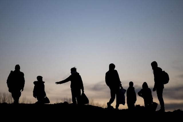 Silhouettes of irregular migrants are seen as they continue to wait near the border gate in Edirne, Turkey to reach Greece on Monday. (Getty)