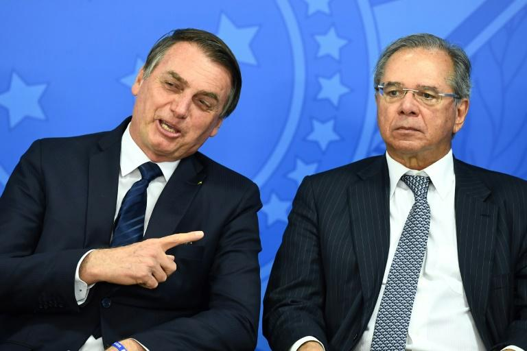 Brazilian President Jair Bolsonaro (L) is seen with his economy minister Paulo Guedes in July 2019