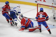 Tampa Bay Lightning's Tyler Johnson (9) scores on Montreal Canadiens goaltender Carey Price (31) as Canadiens' Erik Gustafsson (32) and Ben Chiarot (8) defend during the third period of Game 3 of the NHL hockey Stanley Cup Final, Friday, July 2, 2021, in Montreal. (Ryan Remiorz/The Canadian Press via AP)
