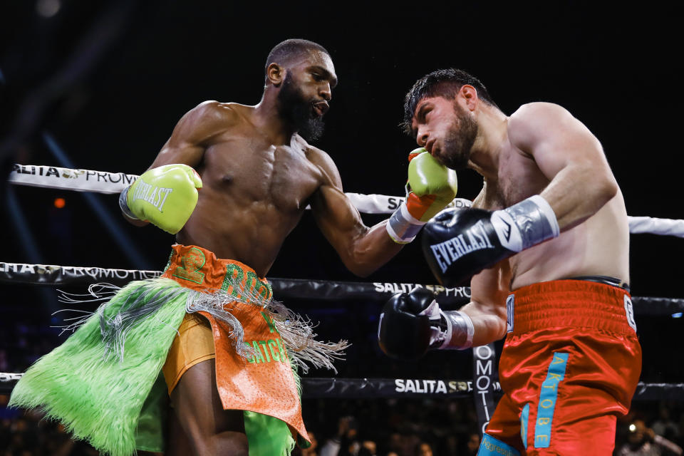 Jaron Ennis, left, throws a left at Bakhtiyar Eyubov during the first round of their boxing bout in Atlantic City, N.J., Friday, Jan. 10, 2020. (AP Photo/Matt Rourke)
