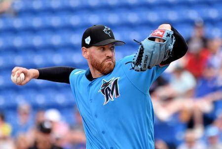 FILE PHOTO: Mar 8, 2019; Port St. Lucie, FL, USA; Miami Marlins starting pitcher Dan Straily (58) throws against the New York Mets during a spring training game at First Data Field. Mandatory Credit: Steve Mitchell-USA TODAY Sports