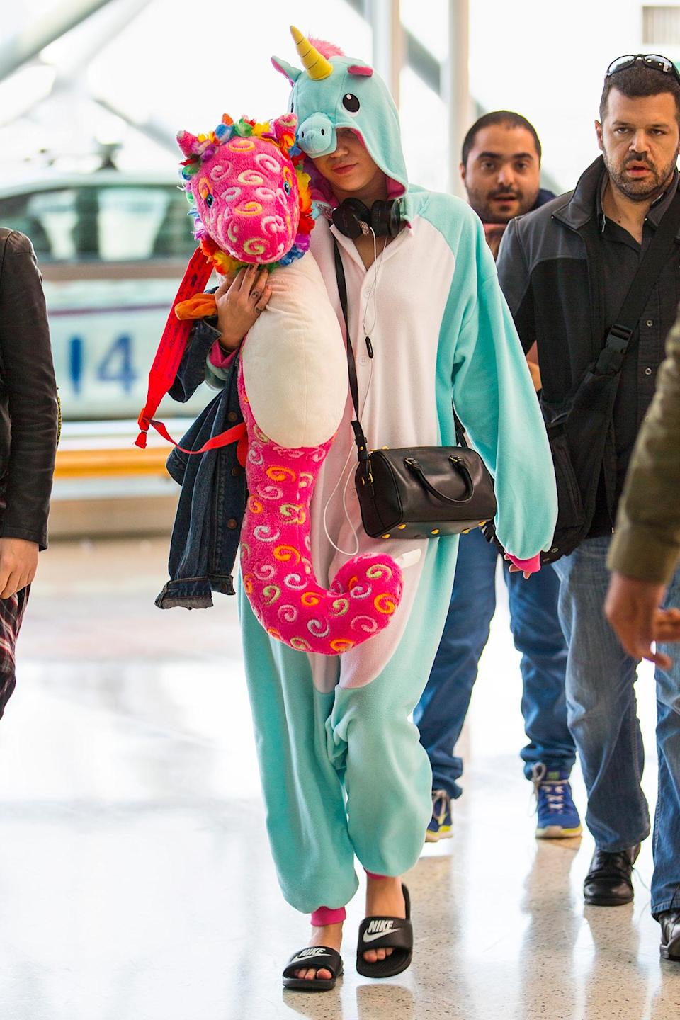 """<p>""""She looks like she's in her pajamas,"""" says Peckman of the unicorn onesie the singer wore in Sydney. """"People dress that way to shield themselves, but they're also creating attention.""""</p>"""