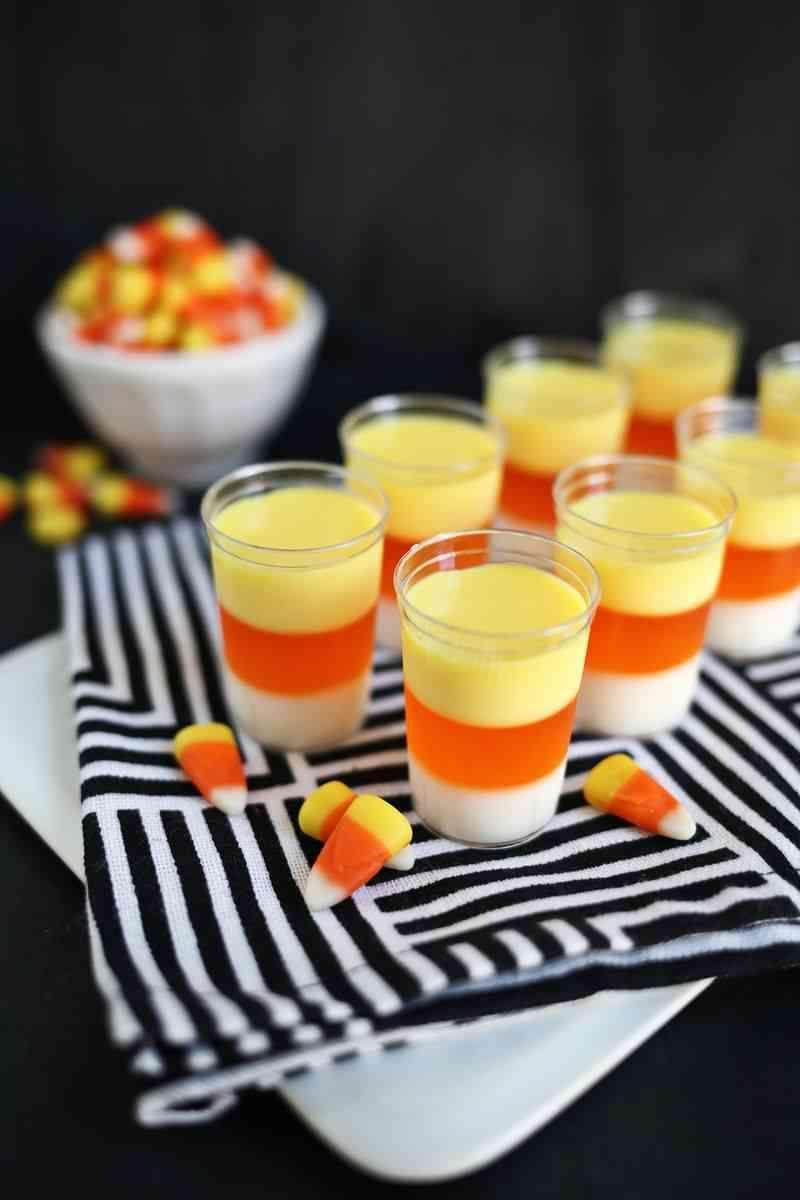 "<p>Candy is dandy but liquor is quicker.</p><p>Get the recipe from <a href=""http://www.abeautifulmess.com/2014/10/candy-corn-jello-shots.html?crlt.pid=camp.7ad8pjMsUtkY"" rel=""nofollow noopener"" target=""_blank"" data-ylk=""slk:A Beautiful Mess"" class=""link rapid-noclick-resp"">A Beautiful Mess</a>.<br></p>"
