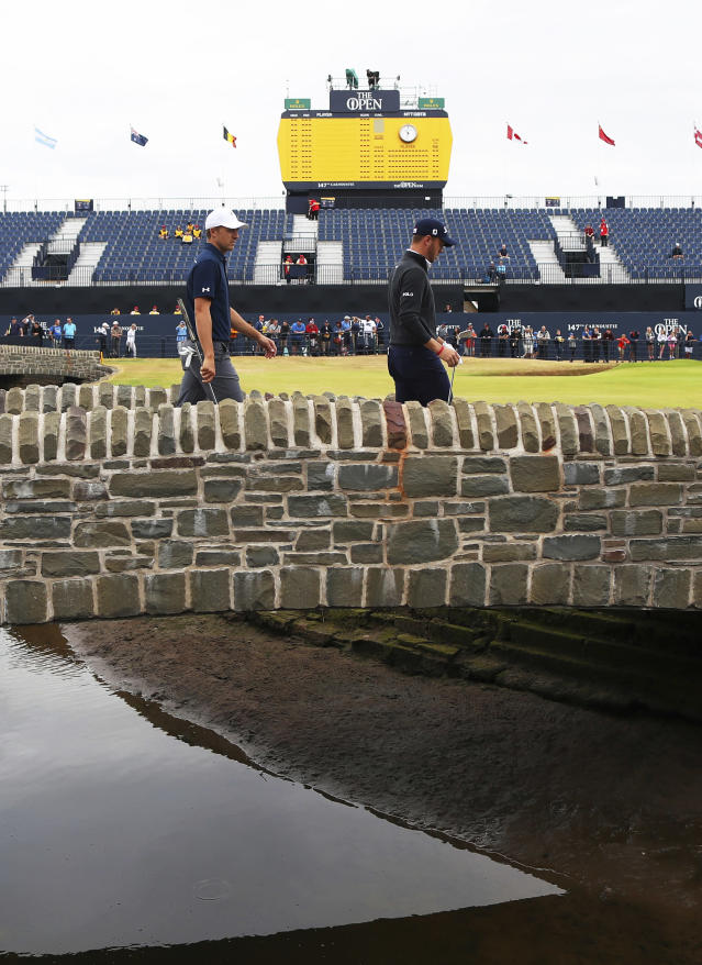 Jordan Spieth of the United States, left, and Justin Thomas of the United States walk towards the 18th green during a practice round for the 147th Open golf Championship at Carnoustie golf club, Scotland, Tuesday, July 17th 2018. (AP Photo/Peter Morrison)