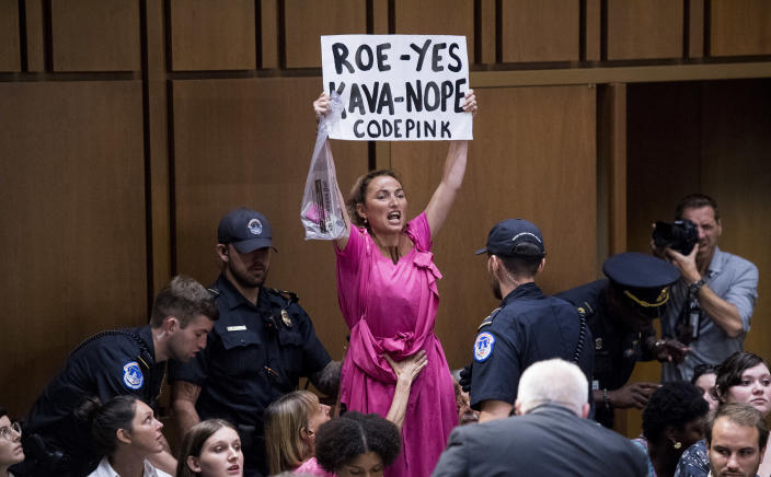 A CodePink protester shouts during Supreme Court nominee Brett Kavanaugh's confirmation hearing in Washington, D.C., on Tuesday. (Photo By Bill Clark/CQ Roll Call)