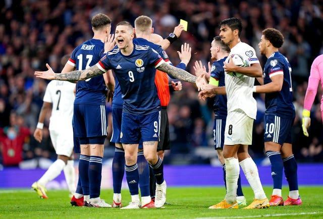 Scotland's Lyndon Dykes reacts after his goal is disallowed