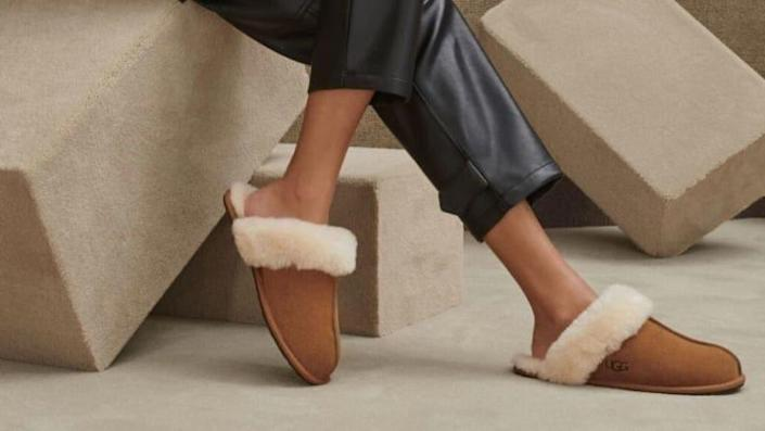 Treat your feet to Ugg's Scuffette slippers featuring a generous amount of shearling wool and traction.