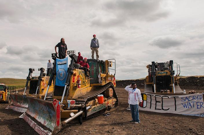 <p>Protesters stand on heavy machinery after halting work on the Energy Transfer Partners Dakota Access oil pipeline near the Standing Rock Sioux Reservation near Cannon Ball, N.D., on Sept. 6, 2016. (Photo: Andrew Cullen/Reuters) </p>