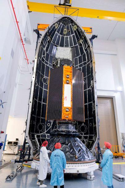 PHOTO:An image provided by the Europeon Space Agency shows the Sentinel-6 satellite being placed inside the upper stage of a Falcon 9 rocket, Nov. 3, 2020. (Stephane Corvaja/Europeon Space Agency via AP)