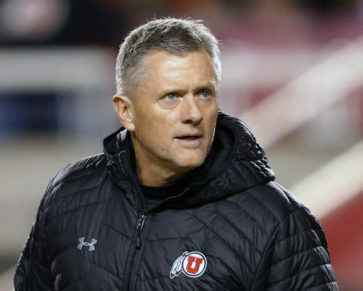 FILE - In this Nov. 24, 2018, file photo, Utah head coach Kyle Whittingham looks on before the start of their NCAA college football game against BYU, in Salt Lake City. Utah coach Kyle Whittingham signed a contract extension Monday, March 4, 2019, that could keep him with the Utes through the 2023 season. Whittingham, the longest-tenured head football coach in the Pac-12, led Utah to a Pac-12 South title and a berth in the league championship game last season. (AP Photo/Rick Bowmer, File)