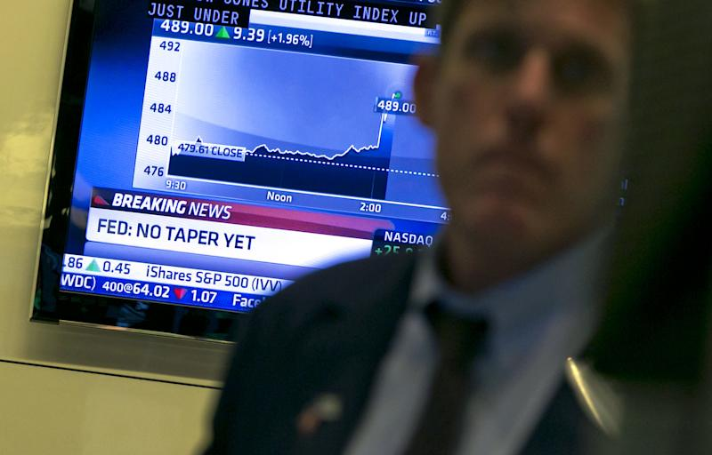 Stock market sets record after Fed keeps stimulus