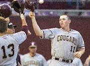 College of Charleston first baseman Nick Pappas, right, is congratulated at home plate after his two run home run in the 7th inning against Auburn at the Tallahassee Regional of the NCAA college baseball tournament in Tallahassee, Fla., Sunday, May 31, 2015. Charleston defeated Auburn 3-2 with Pappas driving in all three runs on home run hits. (AP Photo/Mark Wallheiser)
