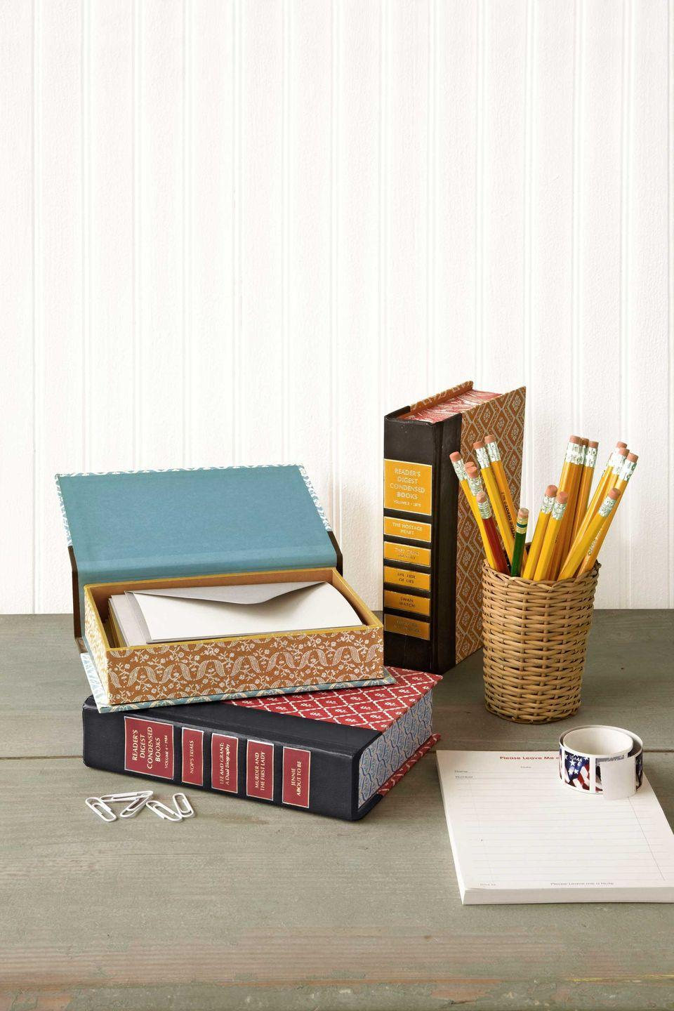 """<p>Extend the shelf life of outdated secondhand books, and give Dad a way to keep his desk organized.</p><p><strong><a href=""""https://www.countryliving.com/diy-crafts/how-to/g741/green-crafts-0309/?slide=35"""" rel=""""nofollow noopener"""" target=""""_blank"""" data-ylk=""""slk:Get the tutorial"""" class=""""link rapid-noclick-resp"""">Get the tutorial</a>.</strong></p>"""