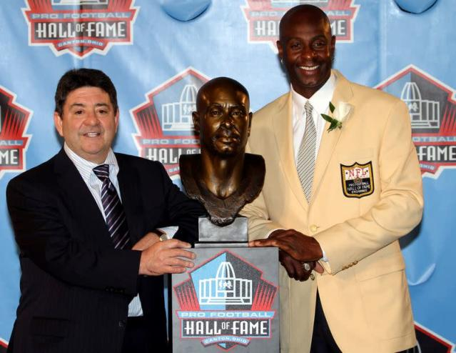 FILE PHOTO: Former San Francisco 49ers great Jerry Rice poses with former 49ers owner Eddie DeBartolo Jr. and his bust after being accepted into the Pro Football Hall of Fame in Canton