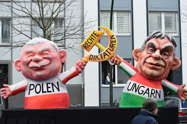 "<p>A carnival float, depicting Polish President Andrzej Duda and Hungarian President Janos Ader holding a hammer and sickle, is pictured during a carnival parade on Rose Monday on Feb. 12, 2018 in Duesseldorf, western Germany. The writing (C) reads ""right dictatorships"". Germany. (Photo: Patrik Stollarz/Getty Images) </p>"