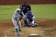 Tampa Bay Rays' Ji-Man Choi singles against the Los Angeles Dodgers during the sixth inning in Game 2 of the baseball World Series Wednesday, Oct. 21, 2020, in Arlington, Texas. (AP Photo/Sue Ogrocki)