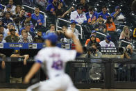 Fans watch as New York Mets' Jacob deGrom (48) delivers a pitch during the fifth inning of a baseball game against the San Diego Padres, Friday, June 11, 2021, in New York. (AP Photo/Frank Franklin II)
