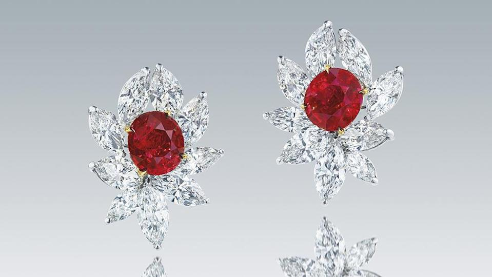 """A Pair of Myanmar """"Pigeon's Blood"""" Ruby and Diamond Earrings. - Credit: Christie's"""