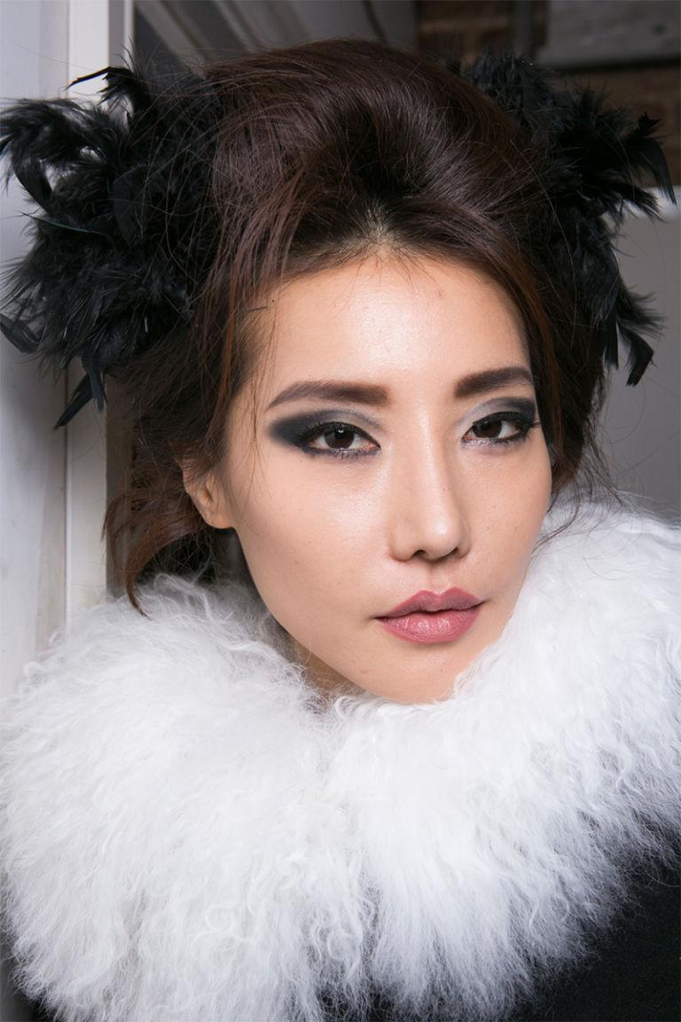 <p>At PPQ, visible lip liner, smoky gray shadow, and hair feathers (yes, feathers) made for one elegant and unusual beauty look.</p>