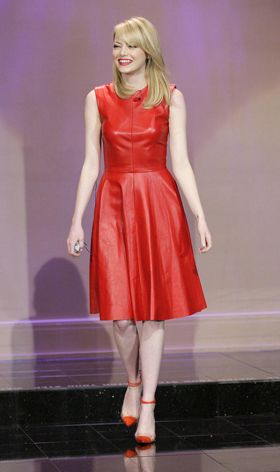 """Leather dresses have taken the fashion world by storm this spring, and, as a result, nearly every female celeb has been spotted wearing one in recent weeks. A standout in the sea of hide-enhanced looks was this sleeveless, fire-engine red Monique Lhuillier frock that Emma Stone donned for a recent appearance on """"The Tonight Show."""" The 23-year-old actress -- who's been busy promoting <a target=""""_blank"""" href=""""http://movies.yahoo.com/movie/the-amazing-spiderman/"""">""""The Amazing Spider-Man""""</a> -- perfectly paired her hot sheath with equally astounding Christian Louboutin cap-toe heels and matching lipstick. (6/5/2012)<br><br><a target=""""_blank"""" href=""""http://bit.ly/lifeontheMlist"""">Follow 2 Hot 2 Handle creator, Matt Whitfield, on Twitter!</a>"""