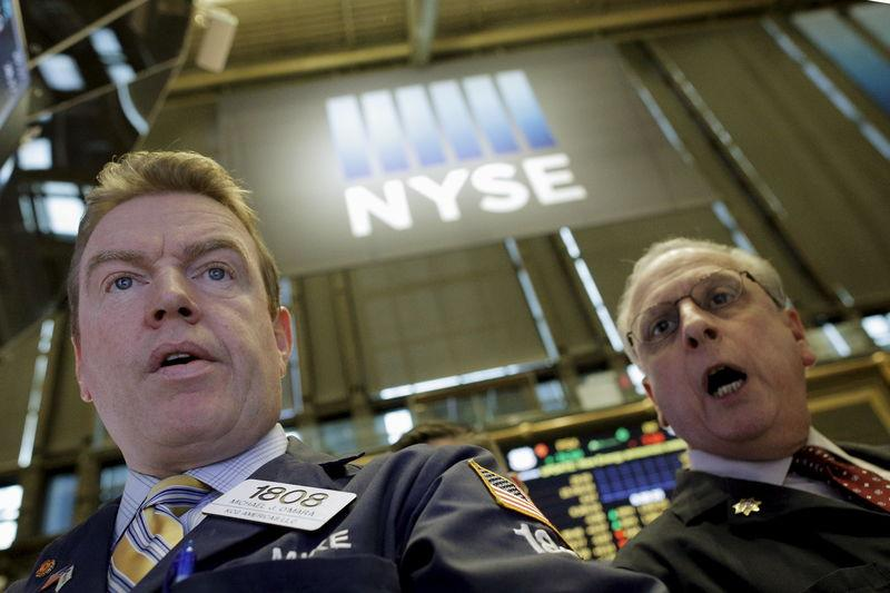 Specialist trader Michael O'Mara works at his post on the floor of the New York Stock Exchange
