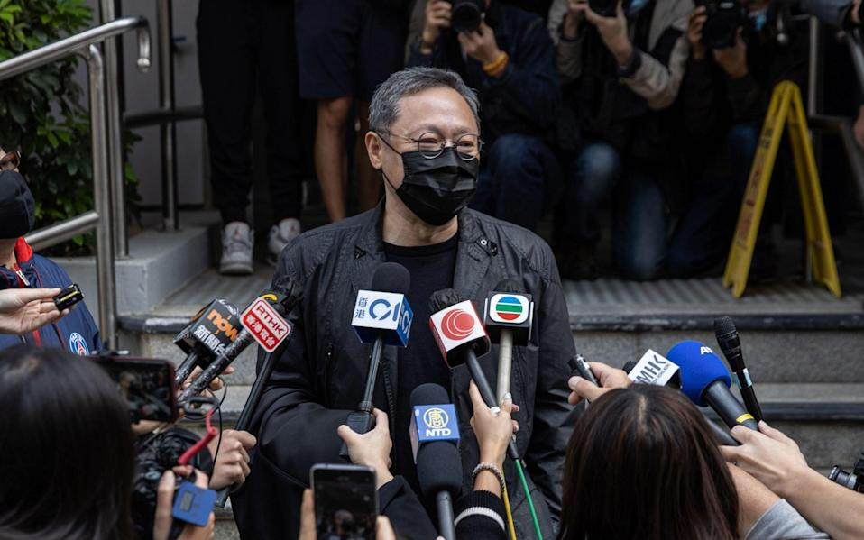 Hong Kong legal scholar and democracy activist Benny Tai Yiu-ting speaks to the press as he prepares to report to the Ma On Shan Police Station in Hong Kong - JEROME FAVRE/EPA-EFE/Shutterstock/Shutterstock