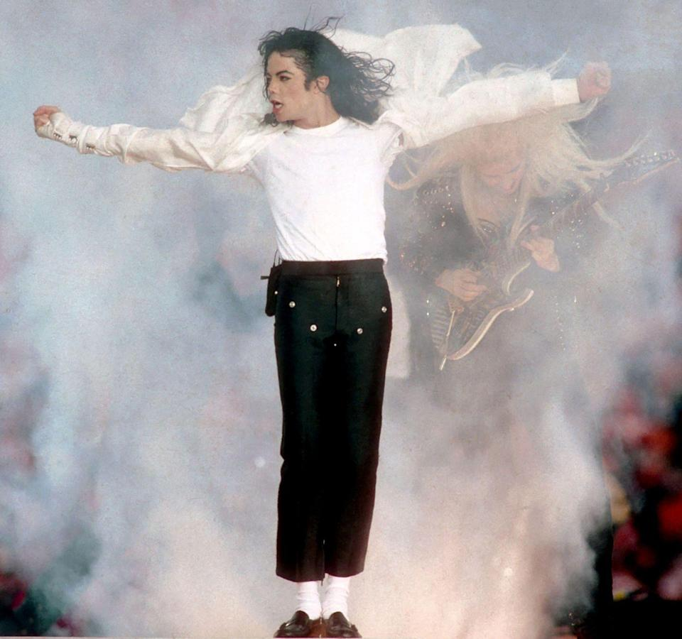 """<p>I'd argue that 1993 is when the halftime show really became a <em>thing</em>, mostly because Michael Jackson showed up looking like some sort of heavenly figure sporting tiny cropped pants. """"SPORTS!"""" he seems to say.</p>"""