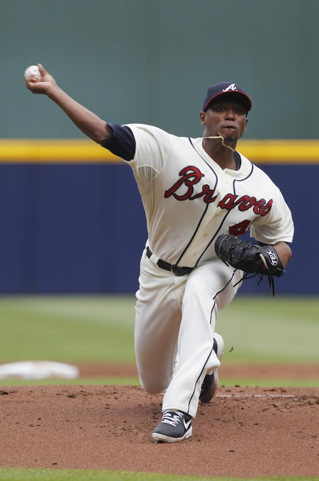 Starting Atlanta Braves pitcher Julio Teheran (49) throws a pitch in the first inning of a baseball game against the San Diego Padres at Turner Field on Sunday, Sept. 15, 2013, in Atlanta. (AP Photo/Butch Dill)