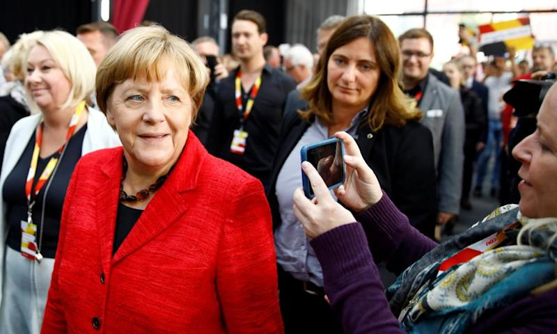 Angela Merkel arrives for an election rally.