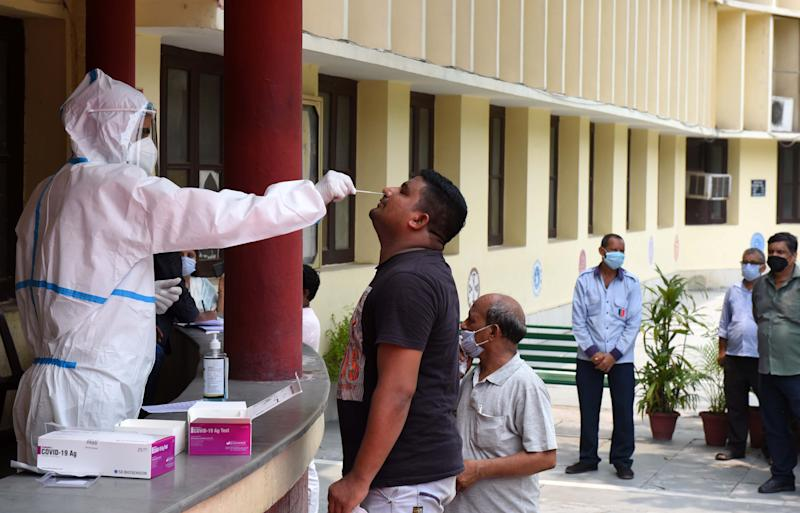 A health worker collects a swab sample for the Rapid Antigen Test for Covid-19 at Happy School at Daryaganj on July 3, 2020 in New Delhi. (Photo: Hindustan Times via Getty Images)