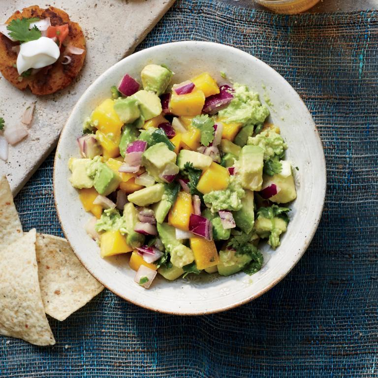 "Offering sweet and tangy notes, mangoes balance perfectly against rich and creamy avocado. Try this guac as a dip with chips or as a topping for fish or chicken tacos. For a step-by-step guide to mango prep, see How to Cube a Mango, below. <a rel=""nofollow"" href=""http://www.myrecipes.com/recipe/mango-guacamole"">Mango Guacamole </a>"