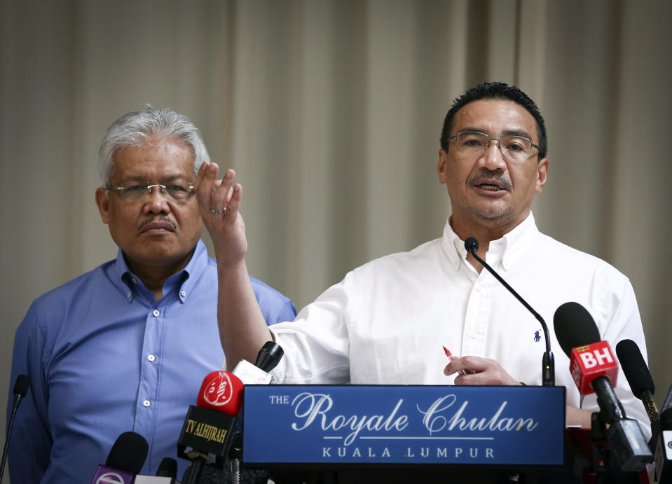 <p> FILE- In this April 19, 2014 file photo, Malaysian Deputy Minister of Foreign Affairs Hamzah Zainudin, left, listens as Malaysia's acting Transport Minister Hishammuddin Hussein answers a question from a journalist during a press conference on the missing Malaysia Airlines Flight 370 at a hotel in Kuala Lumpur, Malaysia. Air traffic controllers did not realize that Malaysia Airlines Flight 370 was missing until 17 minutes after it disappeared from civilian radar, according to the preliminary report on the plane's disappearance released Thursday, May 1, 2014, by Malaysia's government. (AP Photo/Vincent Thian, File) </p>